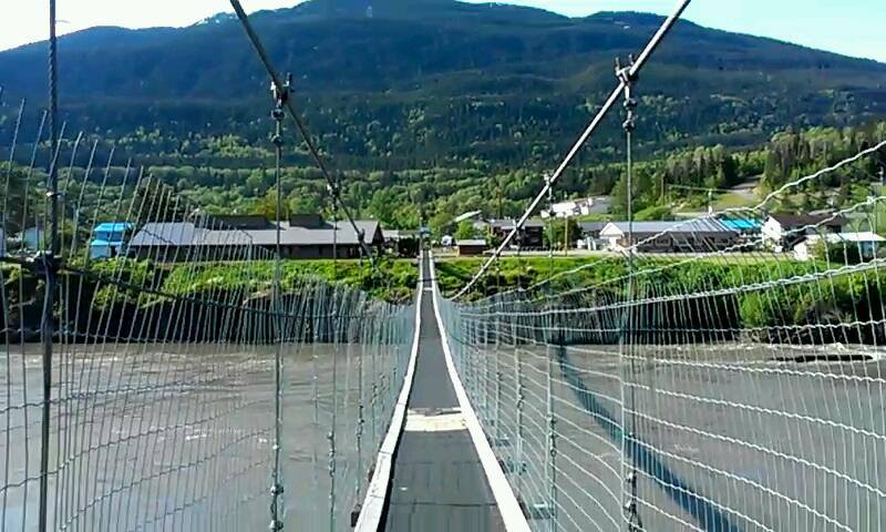 """Suspension bridge over Lisims (the Nass River) at Gitwinksihlkw. It's long, it's high, it's narrow, and the wind is strong. For 400 years, this was the only kind of bridge across the river; in the late 1990's the """"car bridge"""" was built."""